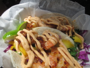 Yum Yum Shrimp Tacos - Shrimp Marinated in Mango, Habanero, and Ginger, topped with house Caribbean sauce