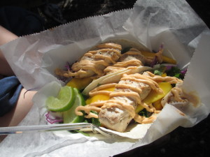 Cayo Fish Tacos - Fresh grilled Mahi Mahi, mango, cilantro, onion jalapeno, red cabbage, and house Caribbean sauce